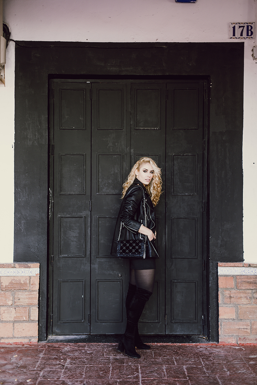 Patripaan total black look with long biker jacket and thigh high boots.