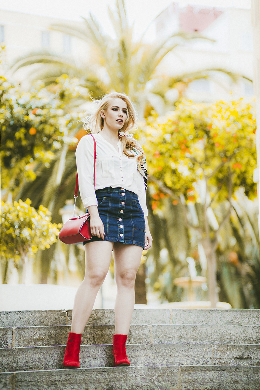 Patripaan spring look with Stradivarius denim skirt, white shirt and red ankle boots.