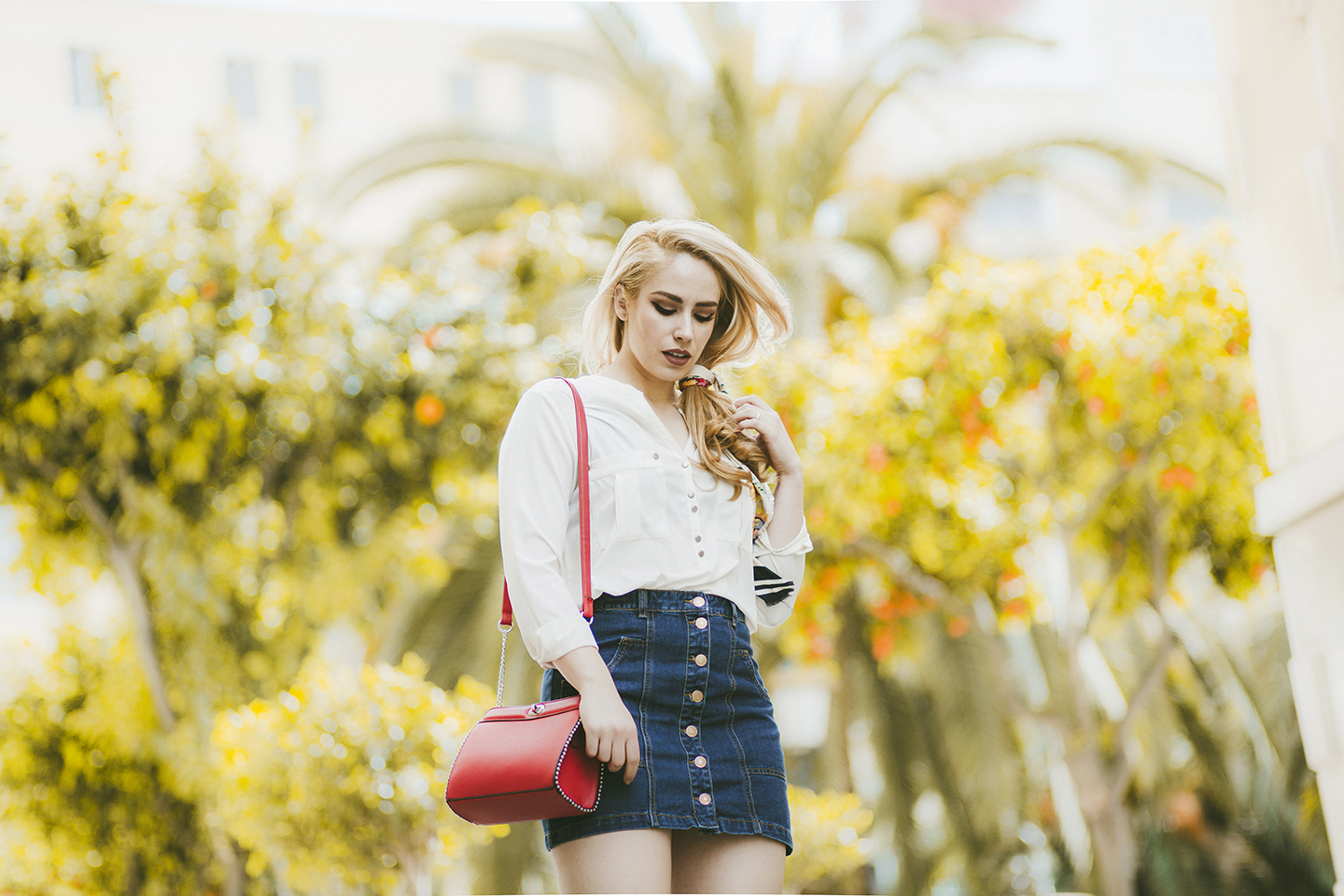 Patripaan spring outfit with denim skirt and white shirt.