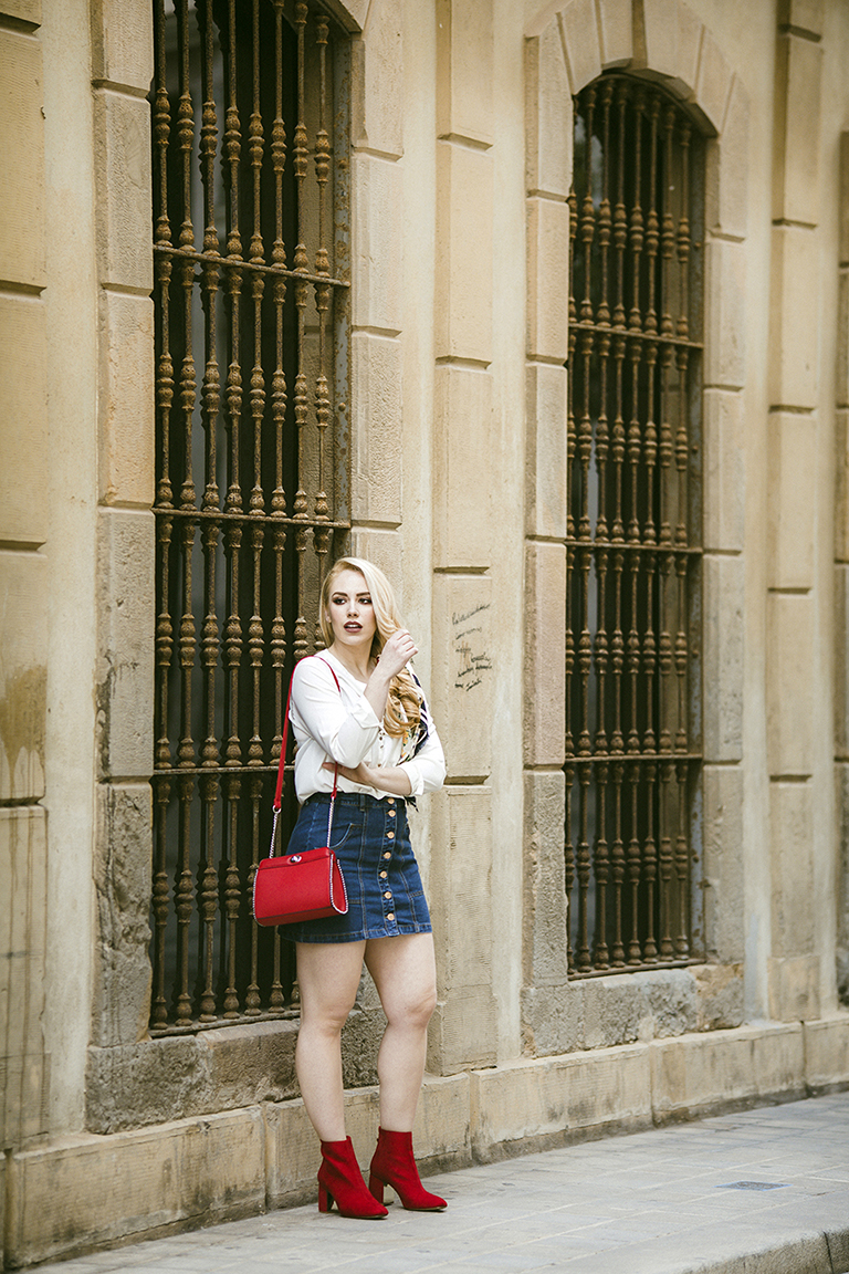 Patripaan spring look with denim skirt, white shirt and red ankle boots.