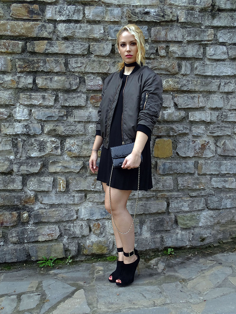 Little black dress and bomber jacket look.